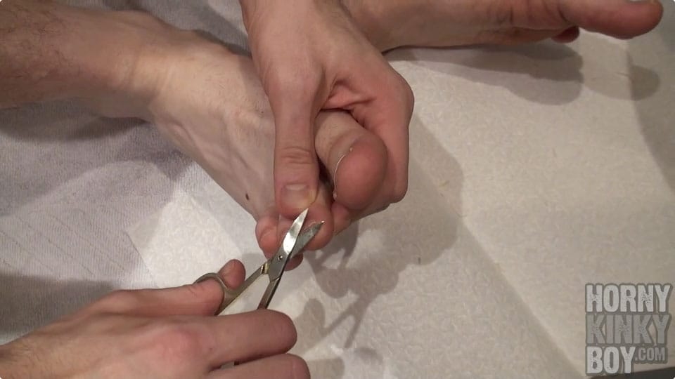 Boy Cuts His Toenails
