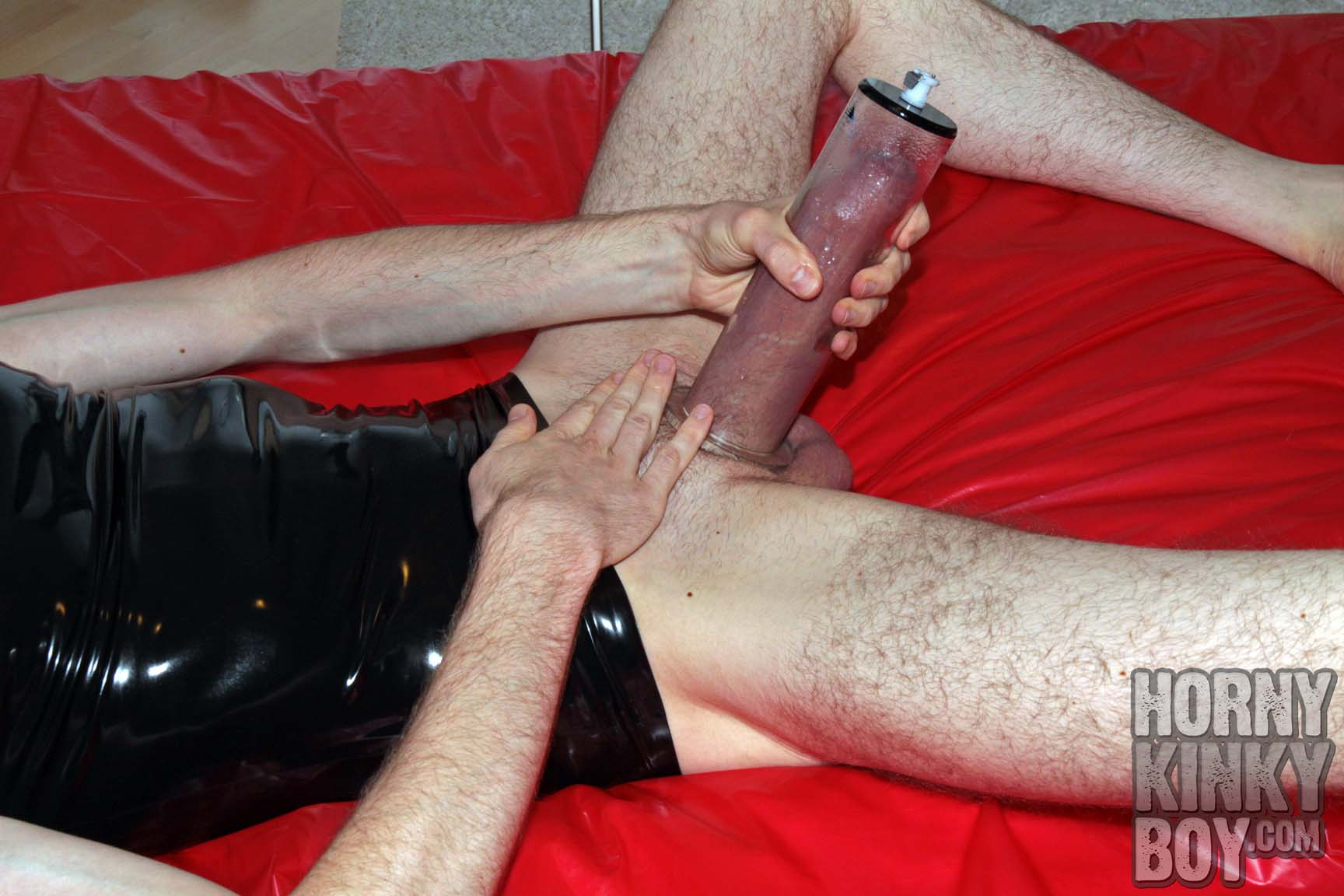 Sexy Rubber Boy Pumps His Meat