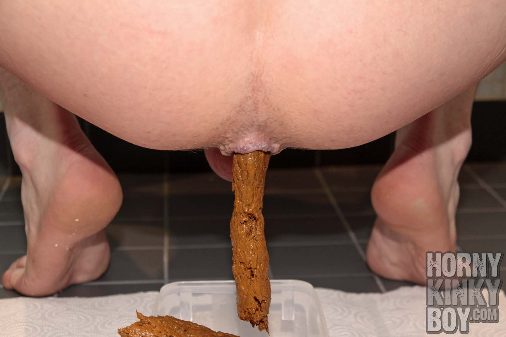 Pooping A Long And Smooth Turd In A Box