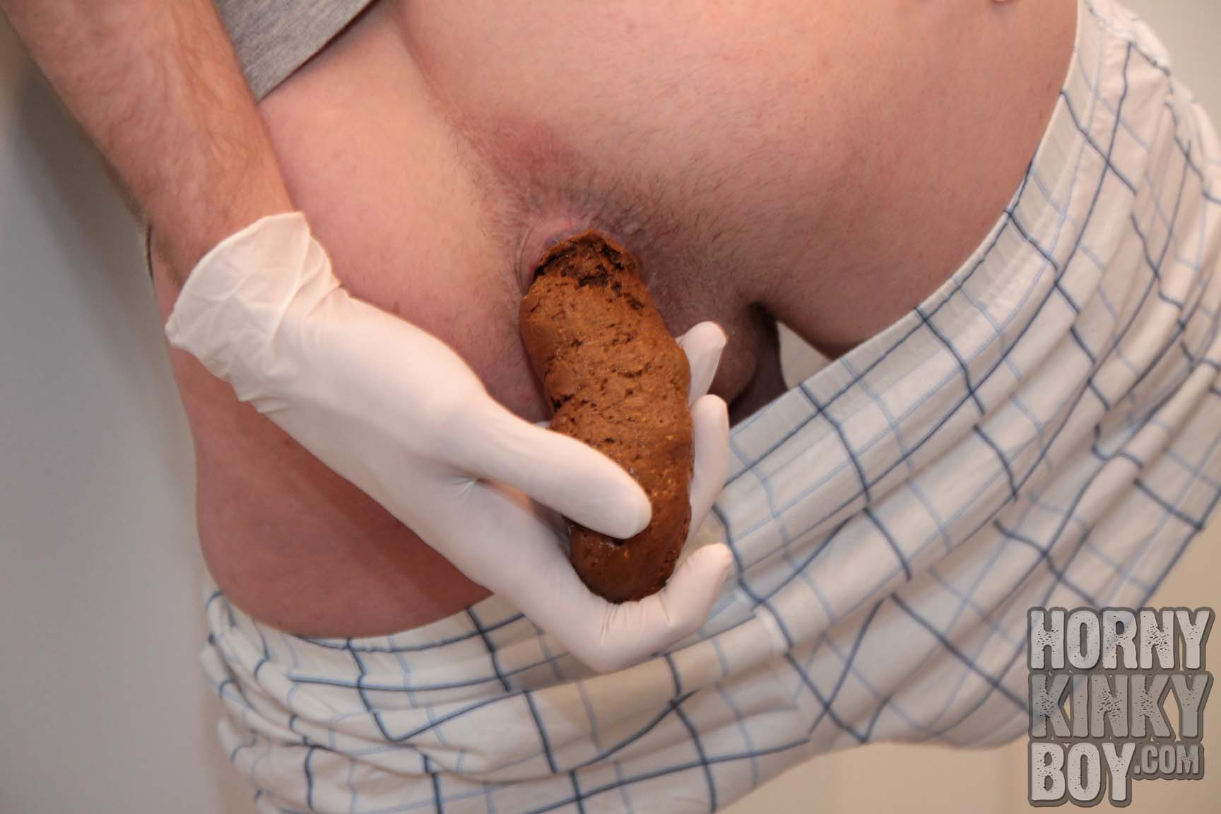 Catching Turd From Poo Hole With Latex Gloves