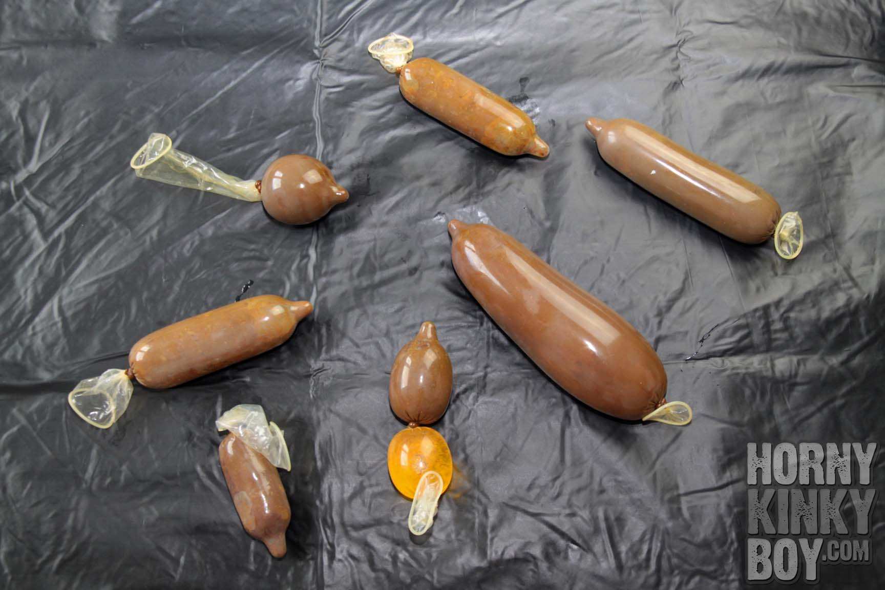 HornyKinkyBoy's Awesome Shit Condom Collection