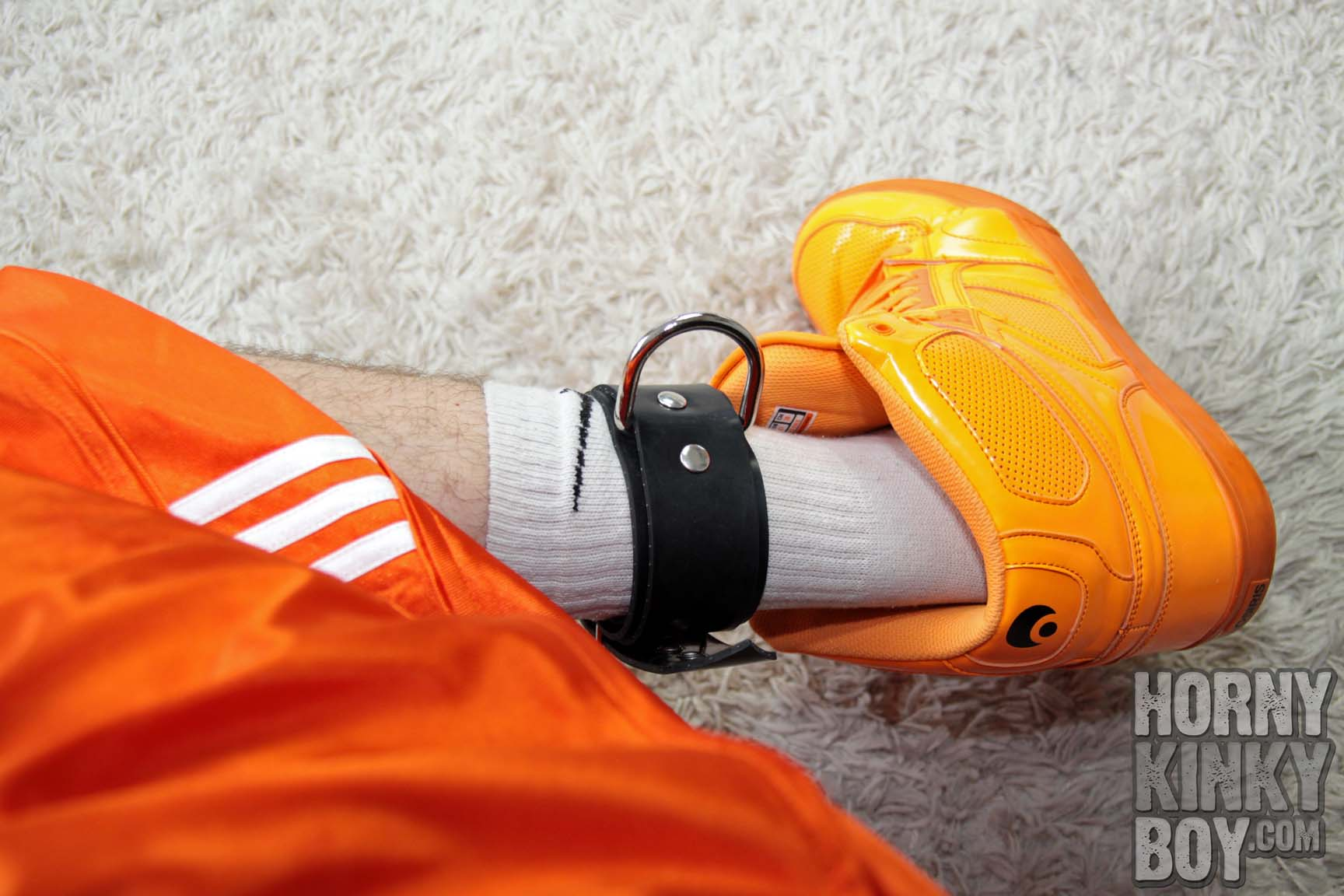 Orange Sneaks, White Socks, Feet, And Rubber Foot Restraints
