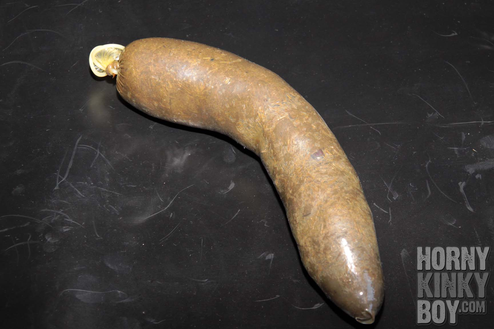 Long Condom Stuffed With Horse Droppings